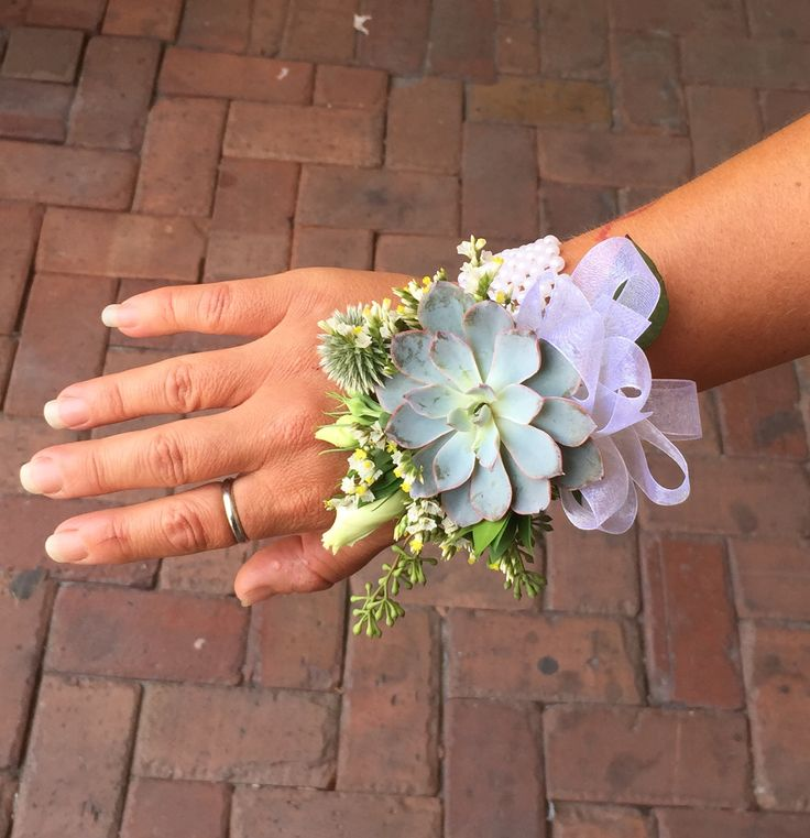 Succulent and seeded eucalyptus wrist corsage by Love In Bloom Florist Key West