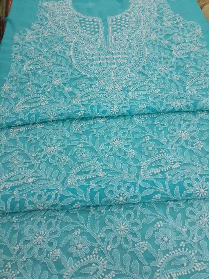 Lucknow Chikan Online Kurta Length Blue Faux Goergette with very fine chikankari murri, shadow & kangan work with full embroidered sleeves & designer neckline   $48.5