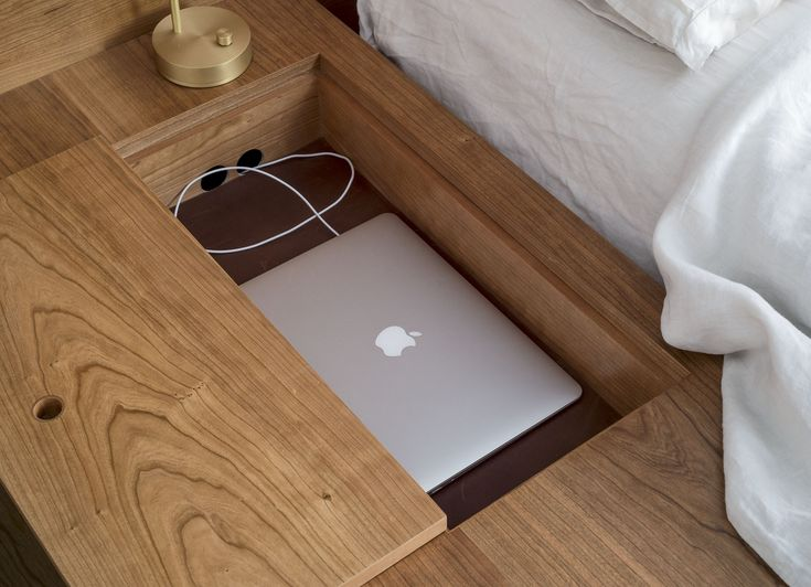 Asher Israel bed frame detail--a built-in laptop slot--in an apartment designed by Workstead, Matthew Williams photo   Remodeista