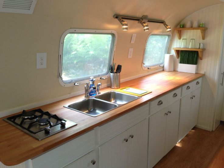 1973 Airstream Sovereign 31 - Texas Nice colors in kitchen, removed upper storage for headroom, wood countertops are pretty but durability (?), like white cabinents/wood counter combo, like track lighting