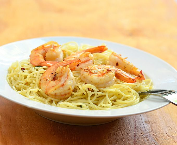 Garlic and butter combine to make a creamy sauce full of flavor.  Shrimp is seasoned and served over a bed of perfectly cooked pasta in this garlic butter shrimp pasta dish.