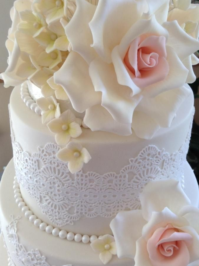 This is my first wedding cake, made for the lovely Carly. She is so easy going and just said she wanted roses, pearls and lace. She told me what kind of design she wanted and then didn't really want any more input and wanted it to be a surprise!...