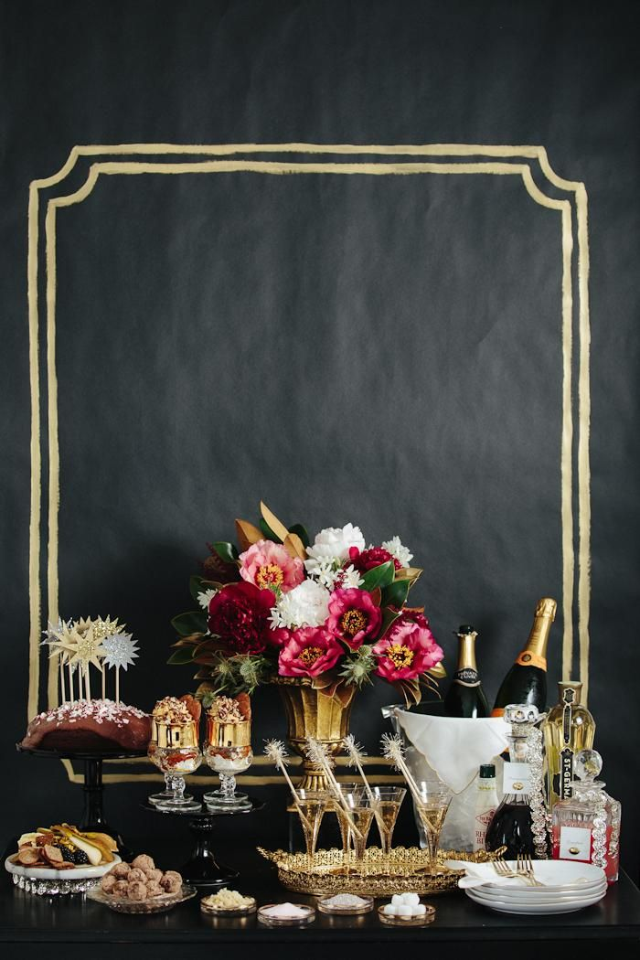 Gold and black party/event table with bright bouquet.