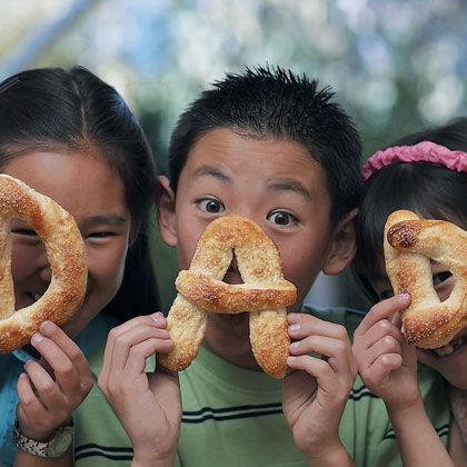 What's better than hot, fresh, salty pretzels? Hot, fresh, salty pretzels shaped into letters that spell D-A-D! Or P-A-P-A or T-H-E M-A-N. This pretzel recipe is easy (the dough is ready-made) and kid-friendly (no boiling is involved). We've also included a quick and delicious honey-mustard dip.