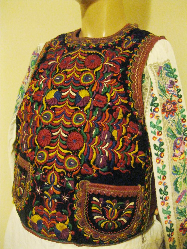50 - 60 years old Romanian  Hand embroidered velvet on sheepskin vest from Transylvania .  Available at www.greatblouses.com