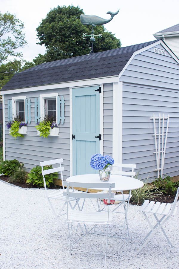 charming coastal style She Shed and pea gravel patio