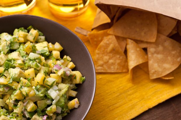 Pineapple and Cucumber Guacamole - This is the best guacamole recipe ever! The Lime Tostitos are a hit to serve with this dish! Thank you Tracy!