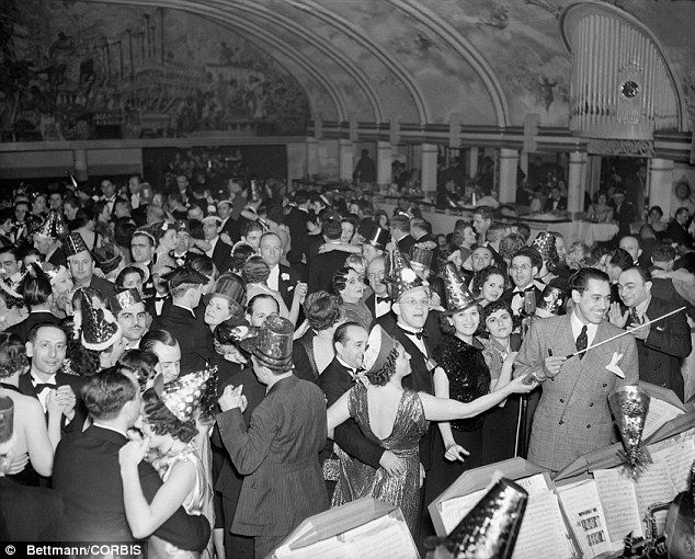 Cab Calloway leads the band at the New Year's celebration of 1937 at the Cotton Club