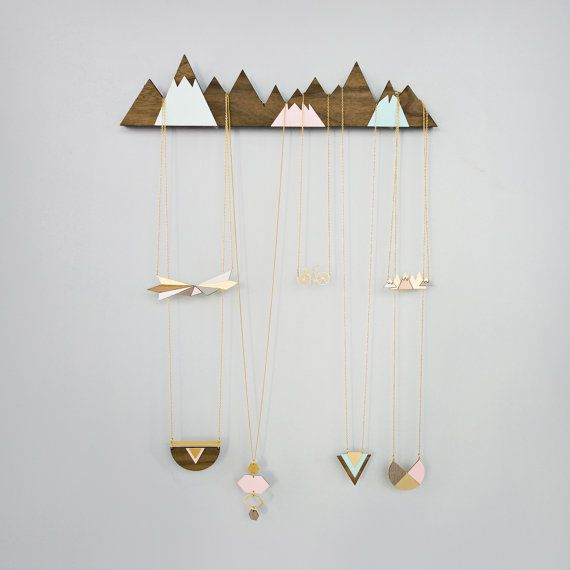 Beautiful wall-mounted jewelry display, portraying a snowy mountain ridge, inspired by Scandinavian design and scenery. Can be easily hung on the