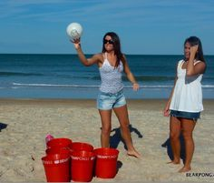 play super-sized beer pong with buckets and volleyball size ping pong ball - fun for beach, backyard, or park.