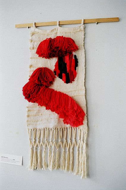 Salish Weaving. Woven on a frame loom by Raili, incorporating tapestry weaving techniques and woven-in fringe embellishment.