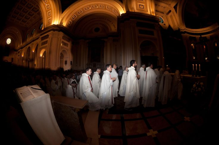 WIDE ANGLE IN THE CATHEDRAL - A procession during a religious ceremony. Wide angle in the cathedral.