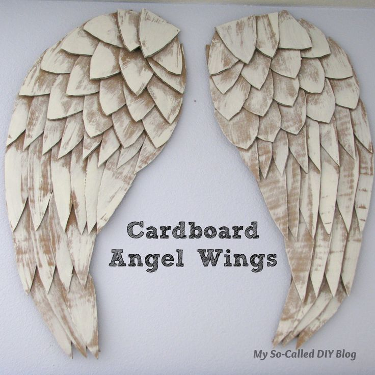 I love the angel wings trend going on right now. I decided to make some large wings using cardboard.   I traced out a design, cut it out...