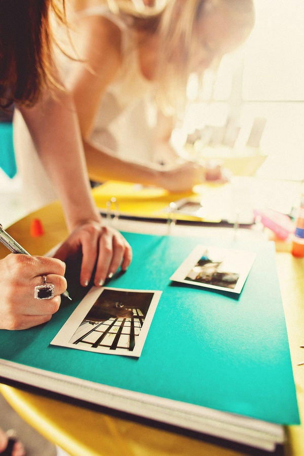Cute guest book idea.... Take polaroids of each guest and have them sign the picture