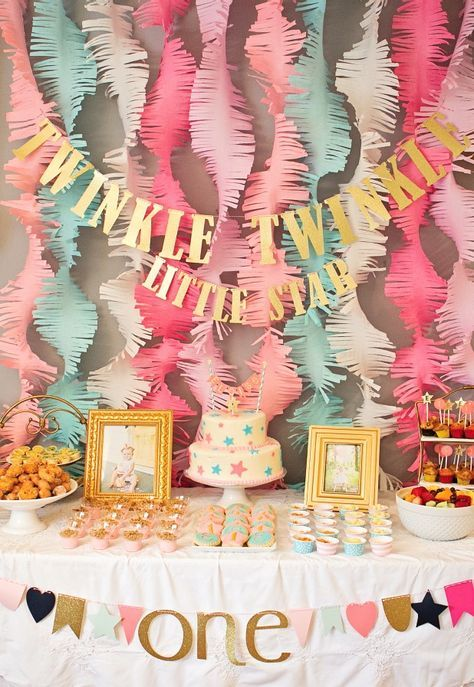 """This """"Twinkle Twinkle Little Star"""" first birthday party, featured on Project Nursery, is a wonderful way to celebrate your baby turning one year old. With pink, coral, and mint decoration ideas, this beautiful birthday bash is every little girl's dream!"""