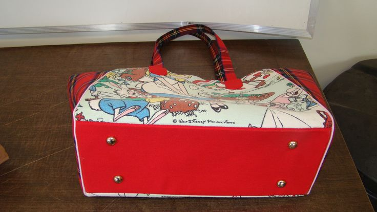 """Bag bottom. I used a heavy red fabric from my stash for this. I added little """"feet"""" to protect the bottom of the bag."""