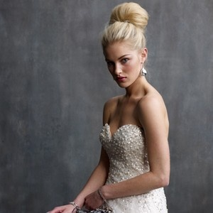 Top knot hair shows off the decolletage