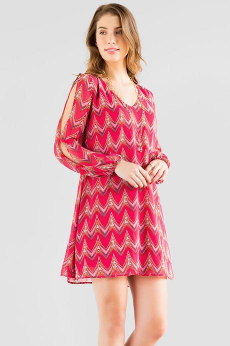 "Chevron+gets+a+new+updated+look+in+the+Oretta+Chevron+Dress!+ This+pink+shift+dress+boasts+a+new+chevron+print+with+crochet+detailing+in+the+back.+ Style+with+wedges+&+simple+jewelry+for+the+perfect+look.<br+/>  <br+/>  -+34""+length+from+shoulder+to+hem<br+/>  -+38""+chest<br+/>  -+60""+sweep<br+/>  -+measured+from+a+size+small<br+/>  <br+/>  -+100%+Polyester<br+/>  -+Hand+Wash<br+/>  -+Imported"
