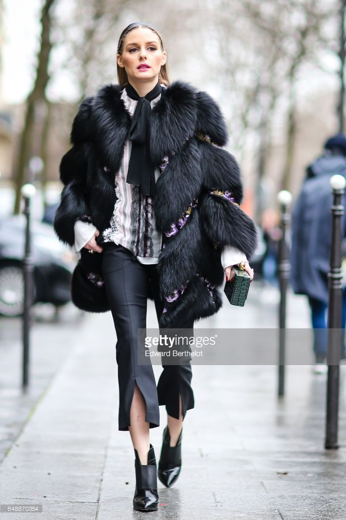 Olivia Palermo wears a black fur coat, outside the Giambattista Valli show, during Paris Fashion Week Womenswear Fall/Winter 2017/2018, on March 6, 2017 in Paris, France.