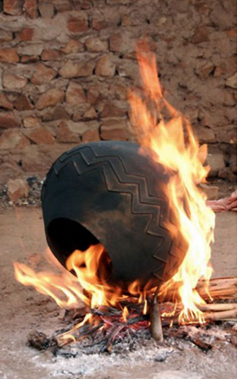 Traditional firing of Isizulu ceramics in KwaZulu Natal.