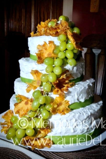 My daughter's wedding cake. Decorated with pineapple flowers and green grapes dipped in lemon jello powder