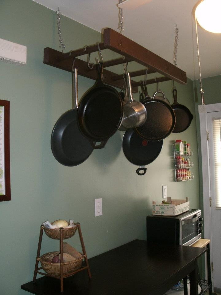 old wooden ladder turn pot rack (cheap but heavy duty hooks can be found at Ikea)