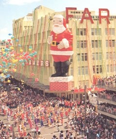Old Farmers building Hobson Street Auckland 1980. The creepiest looking Santa Claus ever, but it was still a great memory of Christmas.