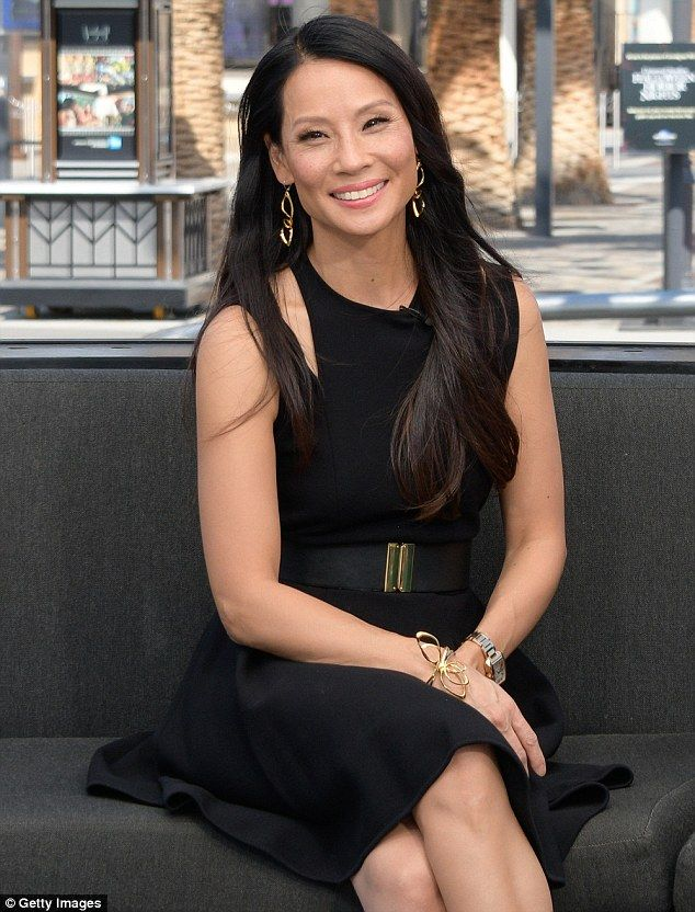 Beautiful in black: On Thursday, Lucy Liu looked the image of glamour when she stopped by Extra at Universal Studios Hollywood to promote her show Elementary