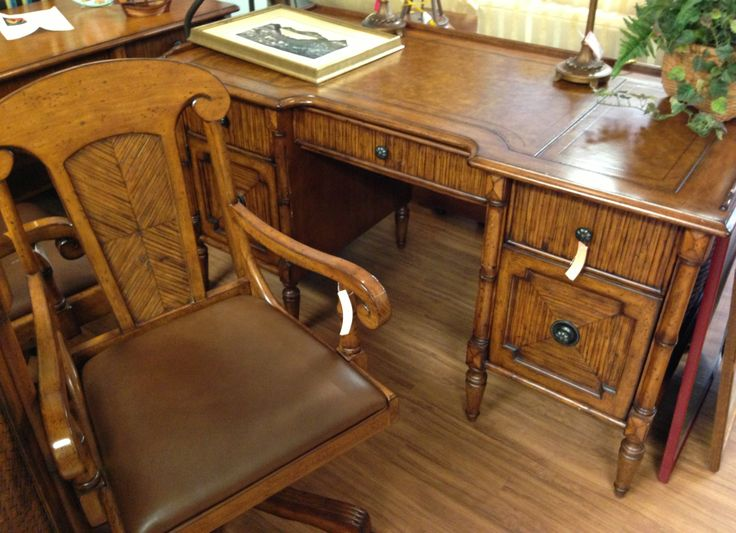 "Tommy Bahama ""her"" desk ($689) and chair ($185)"