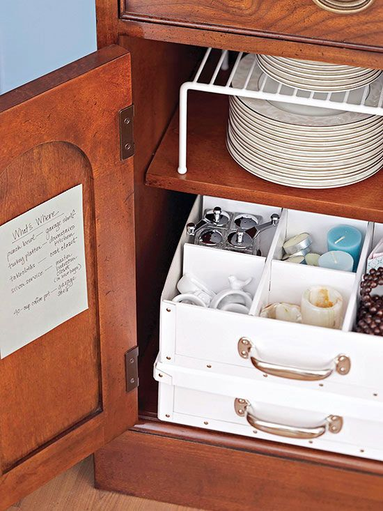 Entertaining Extras Organize small entertaining extras, like tea lights and napkin rings, in a storage caddy designed for tea cups./