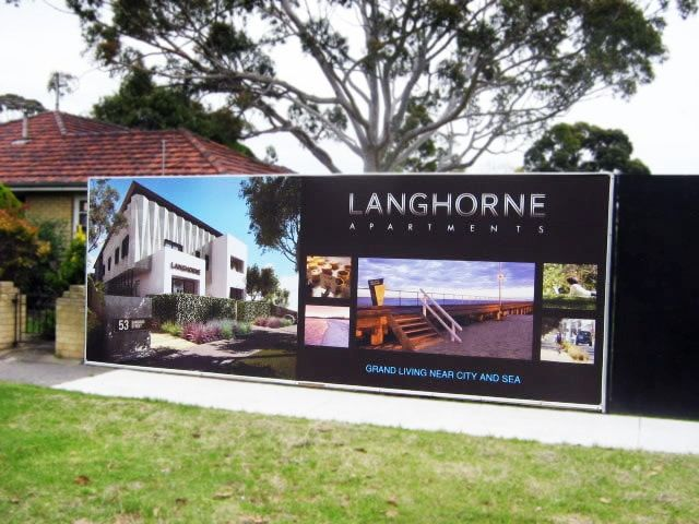 Hoarding banner to advertise for a real estate development.