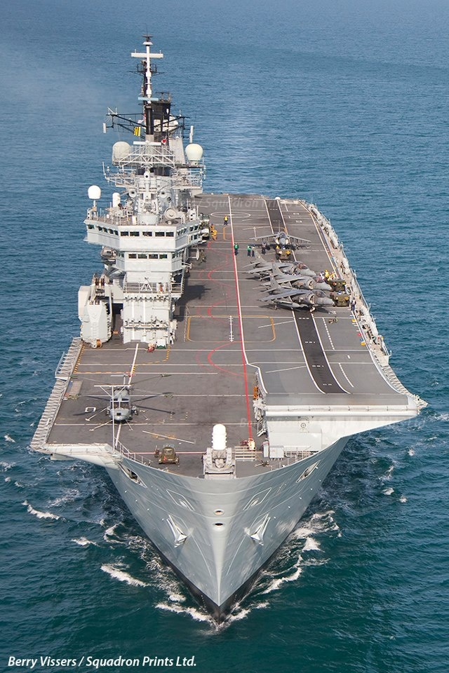 HMS Ark Royal, taken from a Merlin HM1 whilst the ship and squadrons were building up for a Joint Warrior exercise. The Four Harriers had just recovered back on the deck after a low level mission through Wales.