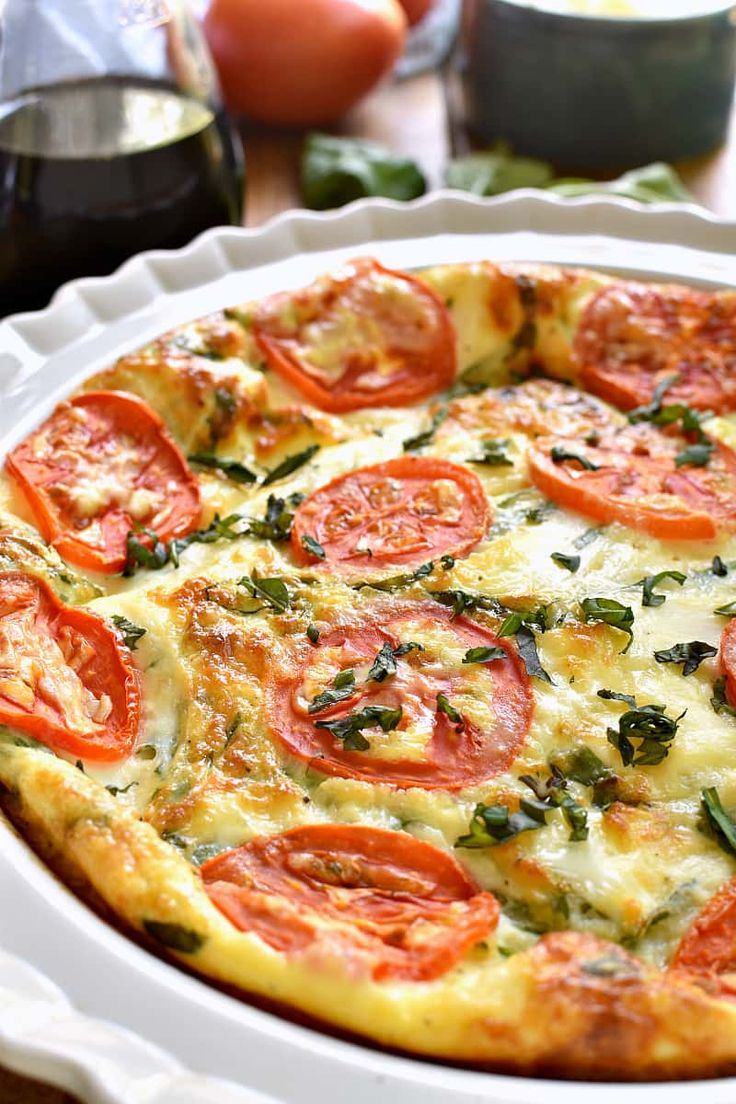 This Caprese Quiche is the ultimate summer breakfast! Loaded with fresh tomatoes, basil, and mozzarella cheese, it comes together quickly and is perfect for breakfast, lunch, or even dinner!