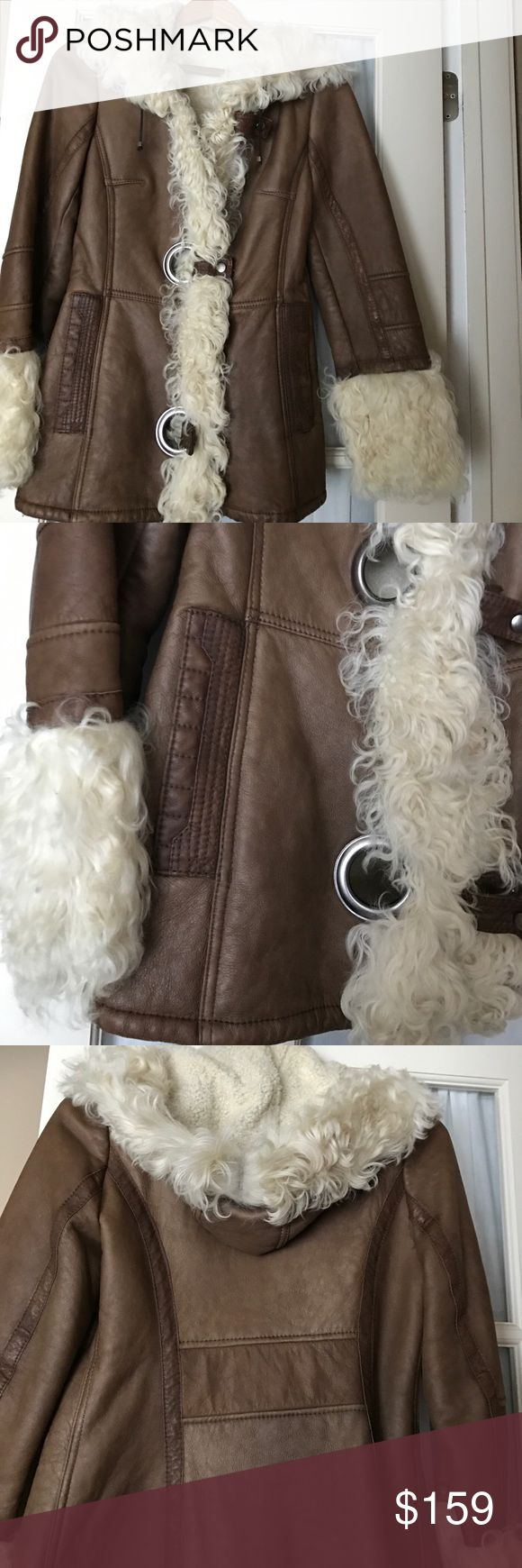 Women's leather jacket with fur Camel color leather jacket fully lined with hood and trimmed in fur. Size medium runs small. Wore once Jackets & Coats