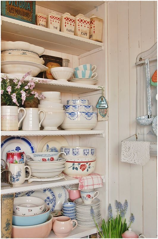 Oh. My. Goodness. I would love all of these dishes and this pretty cabinet.