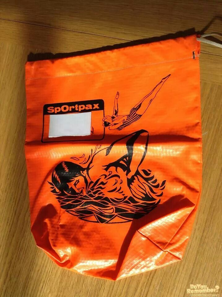 Swimming bag, been looking for a picture of this!  You could get red, blue, green, orange and yellow bags with a choice of swimming, football and other sports.  I had this in red.