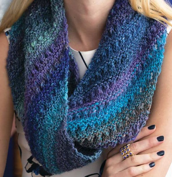 Knitting Pattern for Eyelet Infinity Scarf - An eyelet and garter ridge pattern slants diagonally across the fabric of this long loop that is wrapped twice as a cowl. Designed by Sarah Radow for multi-color yarn. One of the patterns in Noro Silk Garden: The 20th Anniversary Collection