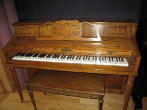 Schafer & Sons  $1,788.00  43″ console, beautiful oak finish, perfect starter piano. Our staff technicians gave this an A+. Small piano, big sound!