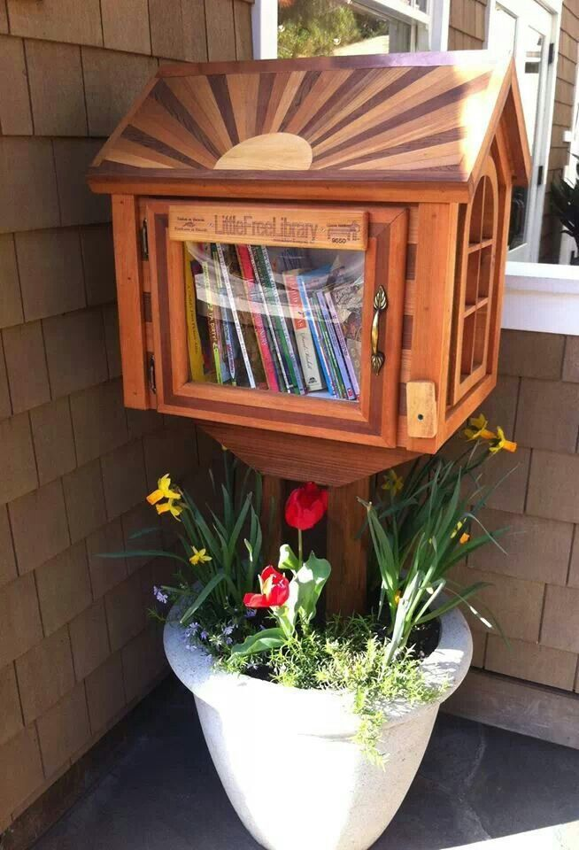 """great idea so we don't have to install on the grounds! """"Little free library in a pot"""""""