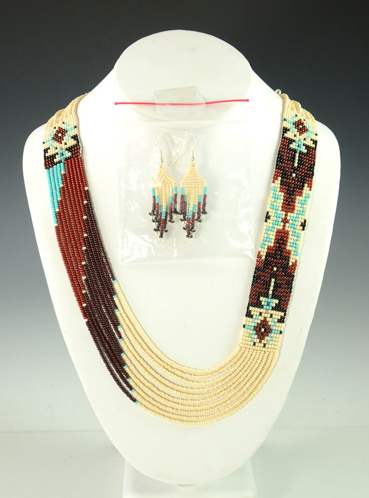 """-- INQUIRE -- ITEM NUMBER: NEC9355 ARTIST: Rena Charles TRIBE: Navajo DIMENSIONS: Measures 29"""" Long By 1"""" Wide MORE DETAILS: Eye-Catching Handmade Beaded N"""