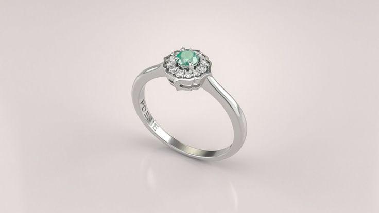 Este anel de noivado combina traços clássicos com suaves formas orgânicas da natureza para criar um design único. Uma bela esmeralda é cercada por
