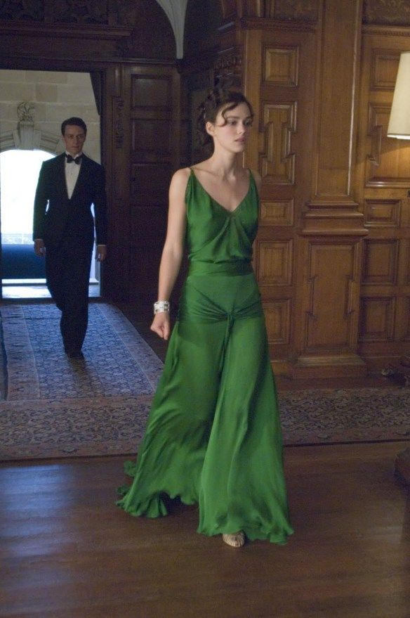 "Keira Knightley in Atonement. ""The moment Knightley appeared onscreen in this emerald green number, I felt the cinema audience give a collective gasp. It is absolutely breathtaking. In the novel, author Ian McEwan wrote pages and pages on Cecilia choosing her dress for the dinner. He wrote about her final look 'a mermaid who rose to meet her in her full-length mirror'. I think the film adaptation did that description justice. There have been essays, analyses and even books written about the…"