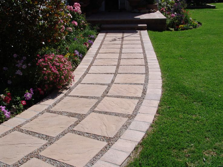 Eden Range Pavers 440x440x40mm and a border of 215x215x40mm in  Amber Rock colourway. Product available from Stonemarket (pty) Ltd. South Africa.