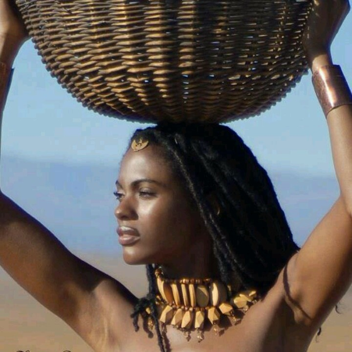 African Beauty: Woman Carrying A Basket On Her Head