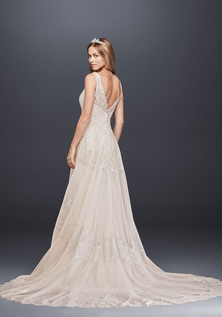 This two-piece Melissa Sweet wedding gown features a tulle A-line tank dress, that sits beautifully over a slim lace column. Pearl and crystal beading on the bodice and bands of eyelash lace lend artisanal detail to this romantic gown. | Vintage wedding dress by Melissa Sweet for David's Bridal