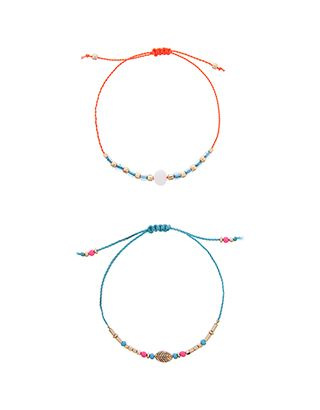 Strung with beads on fine cords, our set of two mini friendship bracelets are a pared-back choice for adding colour to your look. Secured with sliding knots,...