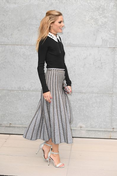 Olivia Palermo arrives at the Giorgio Armani show during Milan Fashion Week Spring/Summer 2017 on September 23 2016 in Milan Italy