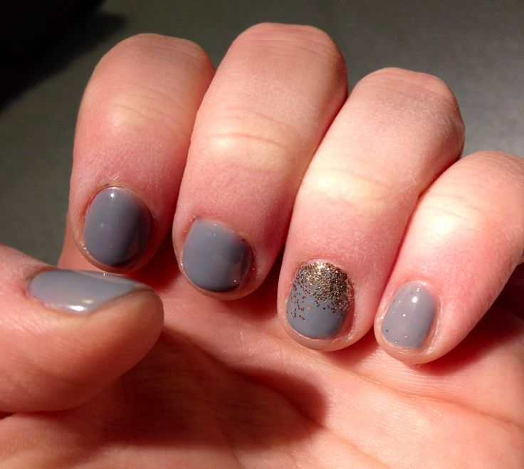 New color! Grey shellac with a gold/peach gradient glitter accent nail. Winter color with a hint of spring!