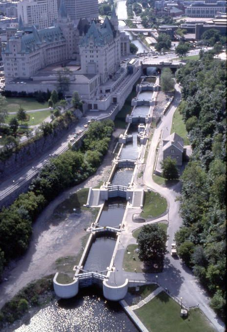 Rideau Canal, Ottawa. The Ottawa Locks are the first of 45 locks (24 lockstations) on the 202 kilometre (125 mile) Rideau Canal. The Ottawa Locks are framed by Parliament Hill on one side and the Fairmont Chateau Laurier hotel on the other.
