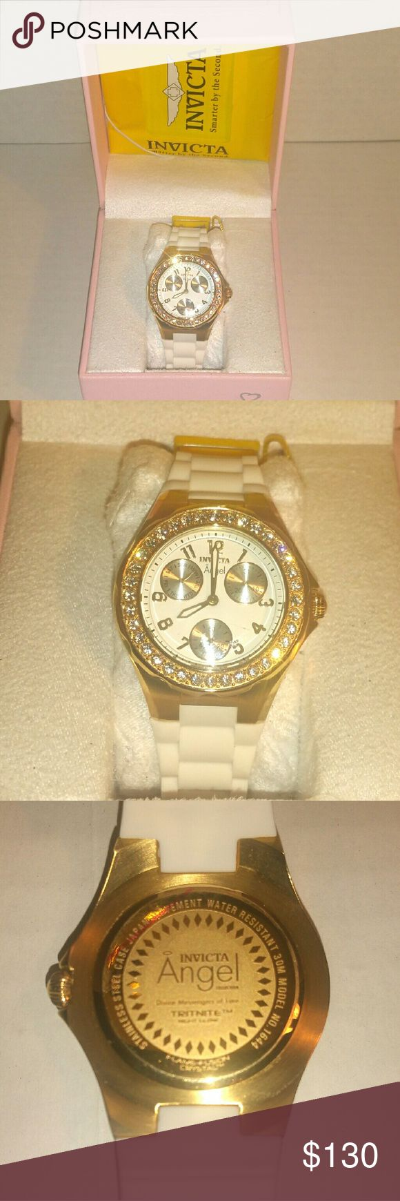 Women's Invicta Watch Women's Invicta watch White and gold with 36 crystals. White silicone watch band. Day, date, and second dials. Worn once. Absolutely no scratches or flaws. Excellent condition. Pet and smoke free environment. Invicta Accessories Watches